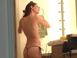Longhaired honey is inserting banana in her luscious muff