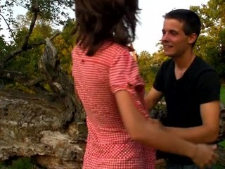 Horny teen chick copulates on a fallen treen outdoors with partner