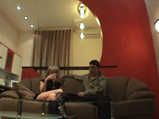 Soft couch is being used by a teen chick as a location for a wild sex