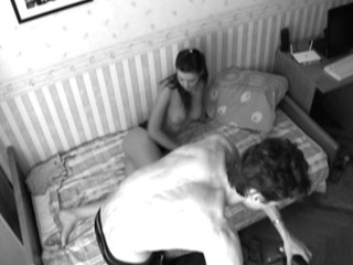 Web camera lens films as dude is nailing honey in black-and-white quality