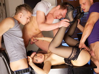 Lewd underware doll in black nylons Taissia gets discharged on hardcore porno clip scene when drilled by three dudes